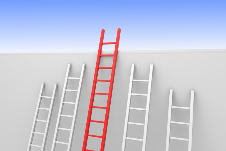 Five ladders leaning against a wall, one reaches the top