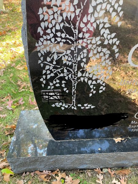 Gravestone with publication list. Photo Justin Joque.