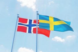 Sweden and Norway, two flags waving against blue sky. 3d image Aleksandra Aleshchenko
